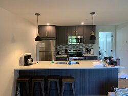 Well appointed kitchen with stainless steel refrigerator, stove, microwave, dishwasher and coffee maker
