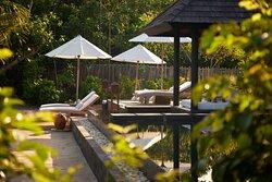 JA Manafaru - Three Bedroom Island Residence with Family Pool & Private Pool. The family Sun lounge area