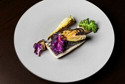Poached striped bass with grilled cabbage, miso and shiitake