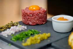 """LE TARTARE """"GAZETTE"""" Hand cut beef tartare (Skirt & Fillet) with gherkins, parsley, onion & capers -Spiced at your table-"""
