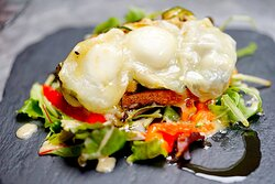 """CROTTIN DE CHÈVRE  Goat's cheese """"crottin"""" toasted with honey, grilled courgette & confit pepper"""