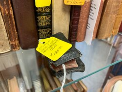 Adams Antiquarian - miniature bible (old and new testament) that includes a small magnifying glass