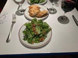 Green salad and sliced baguette