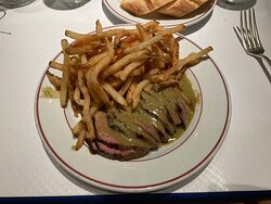 Sliced steak and French fries