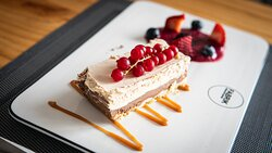 Mascarpone white chocolate cake with red fruit coulis