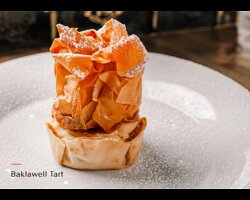 Filo puff with almond cooking cream toped with icing sugar and served with and option of ice cream