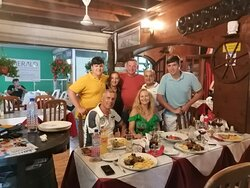 We make a photo with owners inside restarunt. You can see some dishes that we ordered