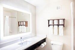 Updated guest bath, lit mirror, quartz counters