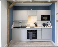 Fully fitted kitchen with oven, hob, dishwasher and microwave
