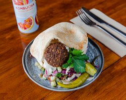 Classic Pita  Falafel, hummus, pickled cabbage, tomato and cucumber Israeli salad, sumac pickled onion, topped with pickles and tahini.