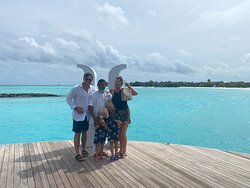Our wonderfull butler Satya and our family in front of the pier Heritage Aarah with the big white H :-)