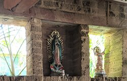 Religious figures in a wall nitch at Si Señor Beach Restaurant.
