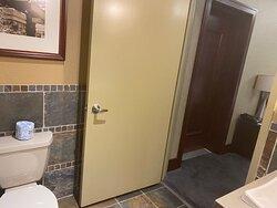 Room 2813 Bathroom, bedroom, and adjoining door to another suite.