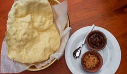 Poppadoms with our homemade mango chutney and spiced onions