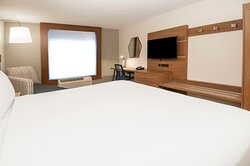 Spacious King Bed with HSIA WIFI, Work Desk, and HDTV.