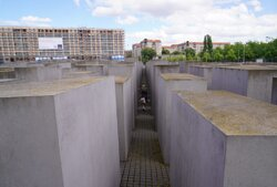 you are allowed to walk through but not sit or stand on them, as they represent graves of killed Jewish during 2nd war