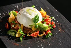 Cherry tomatoes marinated in olive oil and balsamic vinegar combined with creamy burrata cheese.