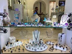A large collection with titanium jewelry and silver jewelry decorated with enamel, handcrafted in Greece.