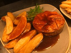 Homemade beef pie with hand cut chips and vegetable's covered with home made gravy.
