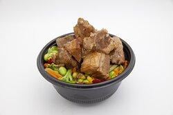 Roast pork with gravy bowl