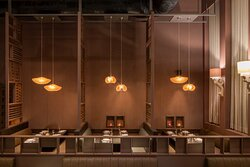 Very classic interiors, the mauve colour is used in a very subtle way, the double height ceiling with mezzanine gives a very grand look. Lighting is perfectly deemed. The over all space looks very modern yet contemporary. Gives a proper fine dine feel.