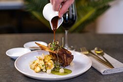 Herb roasted rack of lamb, crushed potatoes, spiced baby onions, mint chutney.