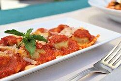 Ravioli in delicious tomato sauce. Authentic Italian taste on your plate.