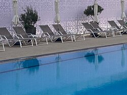 Very large pool, with a baby pool too. Comfortable sunbeds with pool service. Tables around the pool to dine all day.
