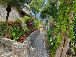 Stone paths and lovely gardens leading down to Hibiscus Cottage