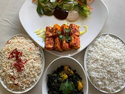 two types of rice and sag aloo served with grill..