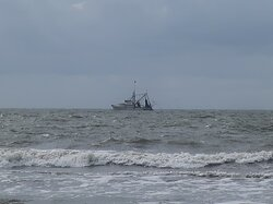 A fishing trawler in the distance