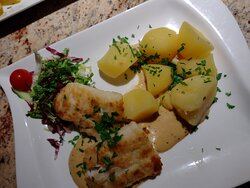Dorsch filet perfectly cooked with well seasoned potatoes.