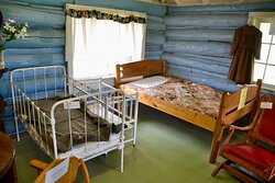 Bed and crib in cabin