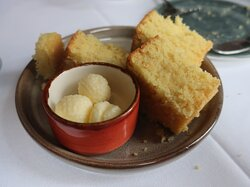 The corn bread and honey butter is superb.
