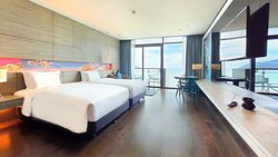 Premier Room with twin beds, balcony and sea view.