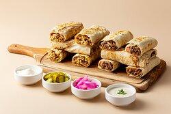 Indulge your appetite with our beef & chicken Shawarma Saj sandwiches! #alkalhaqatar #shawarma #beefshawarma #chickenshawarma #shawarmalovers