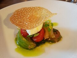 Course #2: Heritage tomatoes with goats cheese mouse and baby basil