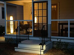 Cottage 16 screened porch at night