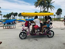 Guests having fun on a Surrey/Quadricycle.