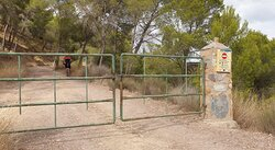 Walk up the left hand road and through the gate: