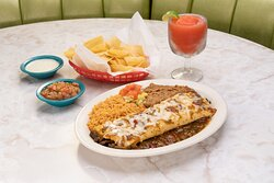 The Steak Burrito is stuffed with grilled steak and jack cheese, topped with Hatch Green Chile Sauce.