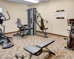 Exercise room with cardio equipment and weights