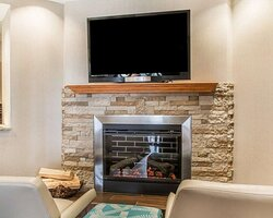 Relax by the fireplace in the lobby