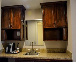 Extra cabinet space and counter space.
