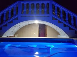 Our pool viewed at night