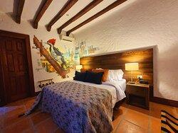 HABITACIÓN ESTÁNDAR DOBLE Ideal para parejas, la habitación estándar doble cuenta con la mejor relación calidad precio para quienes quieren vivir Santa Fe de Antioquia y hospedarse en una habitación moderna.