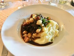Beef cheek with pork loin, onions and mashed potatoes.