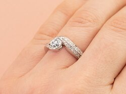 Our stunning Daisy side-stone engagement ring and custom designed wedding band are a perfect fit!