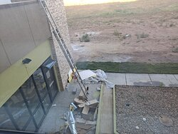 construction debris and mess outside window, very unsightly.,