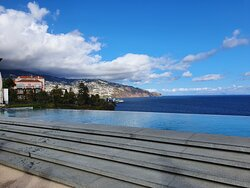 Les Suites Infinity Pool looking out over the Funchal Bay.